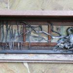 Анатолий - мастер художественной ковки и резьбы по дереву.
